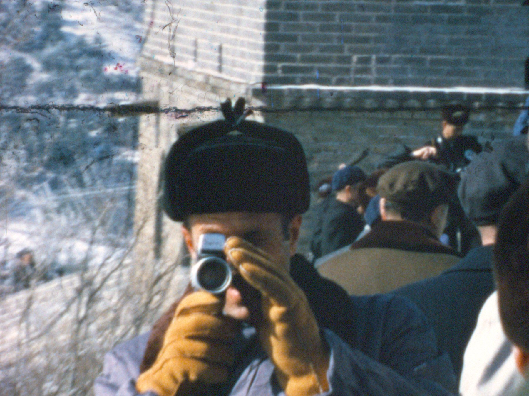 "Chief of Staff H.R. ""Bob"" Haldeman, one of the amateur filmmakers whose Super 8 footage is showcased in the film, films his assistant filming him at the Great Wall of China (February 1972). Super 8 film still courtesy of Dipper Films."