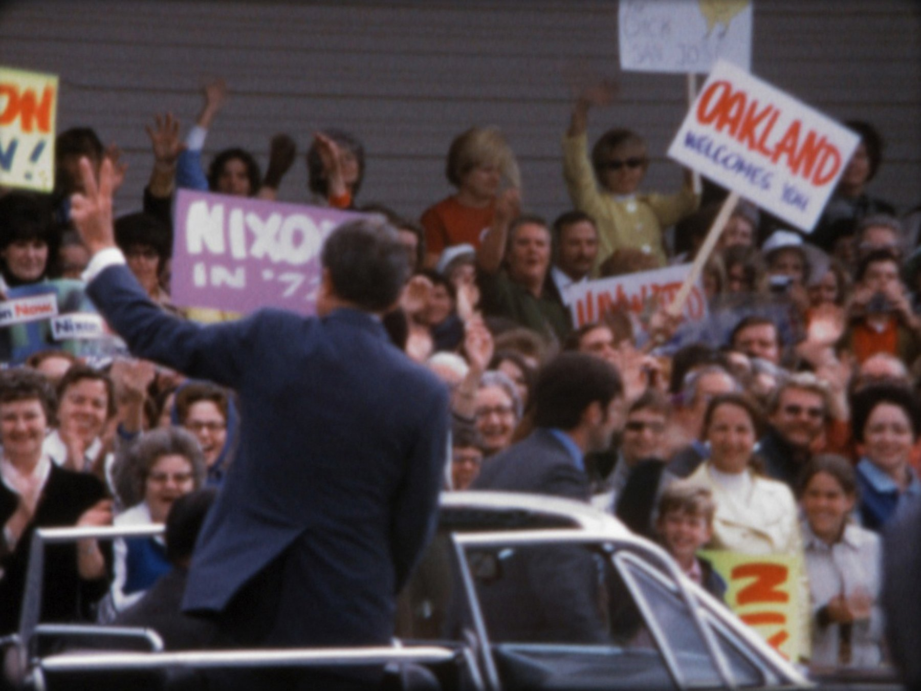 Cheering crowds greet President Nixon on the 1972 campaign trail in California. Super 8 film still courtesy of Dipper Films.